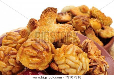 closeup of a pile of panellets, typical pastries of Catalonia, Spain, eaten in All Saints Day, on a white background