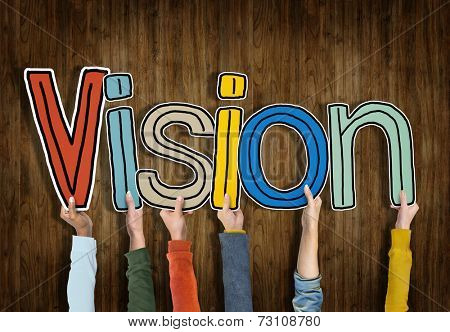 Group of Hands Holding Letter Vision