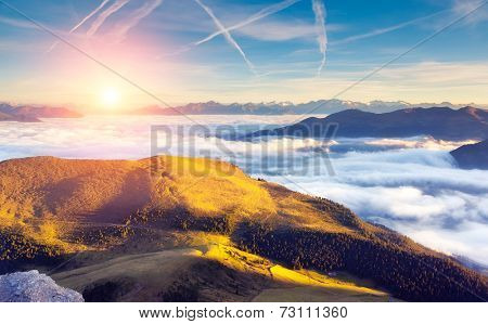 Great view of the foggy Val Gardena valley. National Park Odle  Geisler. Dolomites, South Tyrol. Location Ortisei, S. Cristina and Selva Gardena. Italy, Europe. Dramatic scene. Beauty world.