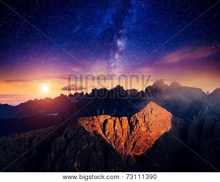 Cadini di Misurina range and Sorapis group under starry light in Natural park Tre Cime di Lavaredo. Dolomites, South Tyrol. Location Auronzo, Italy, Europe. Astrophotography. Beauty world.