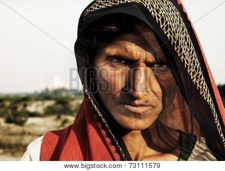 Indigenous Indian woman looking at the camera unhappily.