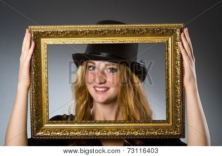 Woman with vintage hat and picture frame