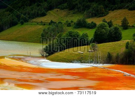red polluted  lake in Romania, Alba, Geamana