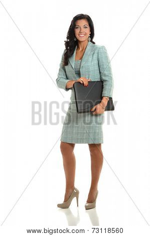 Portrait of beautiful businesswoman holding binder isolated over white background