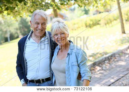 Senior couple walking together in park