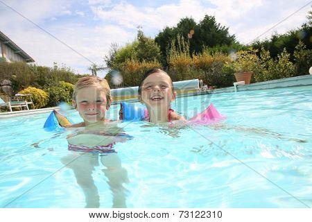 Kids playing in swimming-pool