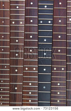 Guitar necks aligned, Rosewood, and ebony fingerboard necks