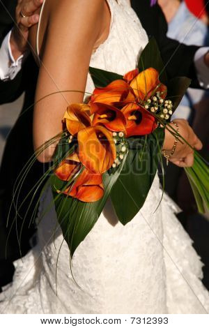 Woman Carrying Bouquet Of Lilies