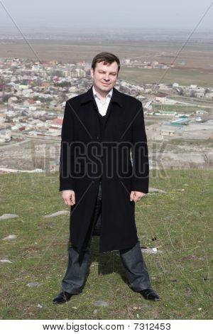 Man Poses On Bishkek Background