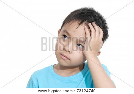 Asian little kid studying at home thinking