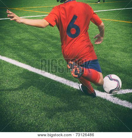 Soccer corner kick with retro effect.