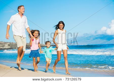 Happy Mixed Race Family of Four on the Beach