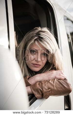 Portrait of a female driver looking at camera