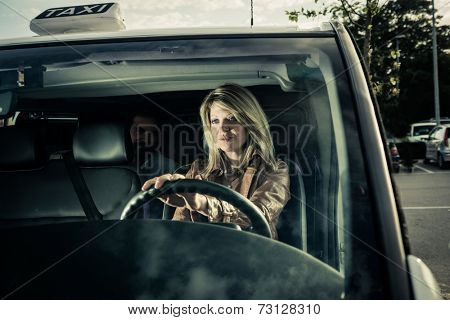 Female taxi driver with passenger