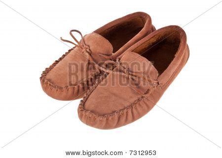 Pair of moccasin slippers isolated on white