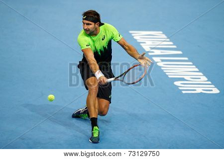 SEPTEMBER 26, 2014 - KUALA LUMPUR, MALAYSIA: Marinko Matosevic of Australia plays a backhand return in his match at the Malaysian Open Tennis 2014. This event is an ATP sanctioned tournament.