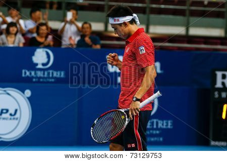 SEPTEMBER 26, 2014 - KUALA LUMPUR, MALAYSIA: Kei Nishikori of Japan reacts after his shot in his match at the Malaysian Open Tennis 2014. This event is an ATP sanctioned tournament.