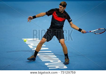 SEPTEMBER 26, 2014 - KUALA LUMPUR, MALAYSIA: Jarkko Nieminen of Finland plays a forehand return in his match at the Malaysian Open Tennis 2014. This event is an ATP sanctioned tournament.
