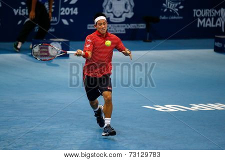 SEPTEMBER 26, 2014 - KUALA LUMPUR, MALAYSIA: Kei Nishikori of Japan makes a forehand return in his match at the Malaysian Open Tennis 2014. This event is an ATP sanctioned tournament.