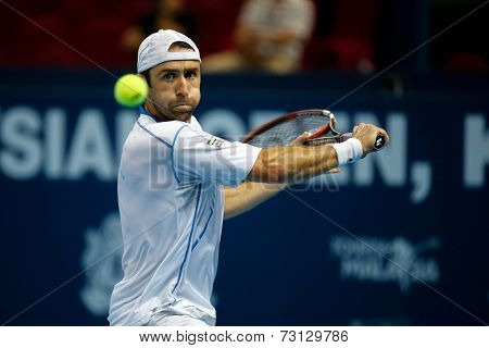 SEPTEMBER 26, 2014 - KUALA LUMPUR, MALAYSIA: Benjamin Becker of Germany  prepares to hit a backhand return in his match at the Malaysian Open Tennis 2014. This event is an ATP sanctioned tournament.