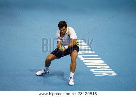 SEPTEMBER 26, 2014 - KUALA LUMPUR, MALAYSIA: Pablo Andujar of Spain plays a backhand return in his match at the Malaysian Open Tennis 2014. This event is an ATP sanctioned tournament.