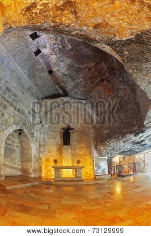 JERUSALEM, ISRAEL - MARCH 9, 2012: Interior of a hall in the Holy Sepulchre. Hall carved into the rock, the floor is made of polished marble