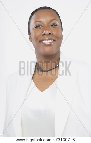 Studio shot of African woman smiling