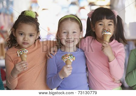 Group of young girls eating ice cream cones