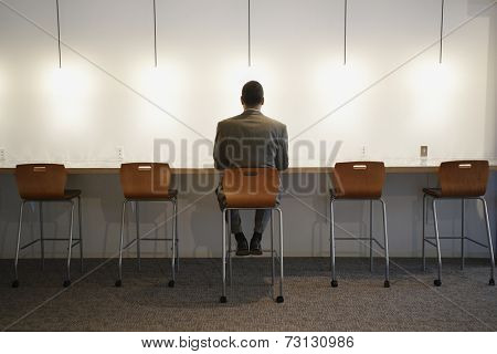 African American businessman sitting in chair