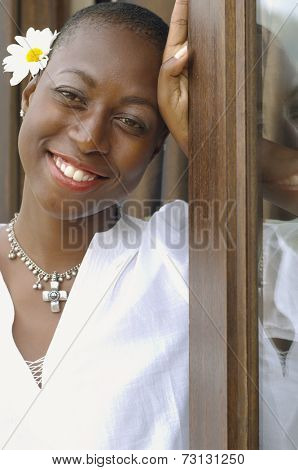 African American woman with flower behind her ear