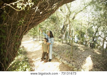 Hispanic mother and son on nature trail