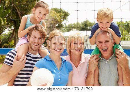 Multi Generation Family Playing Volleyball Together