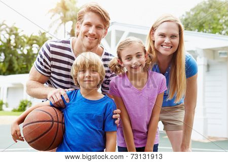 Portrait Of Family Playing Basketball Together