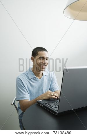 Young African man using laptop
