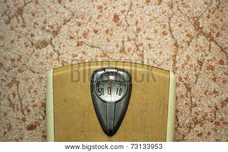 Scale from 1950's on linoleum floor