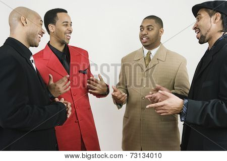 Group of African American businessmen laughing