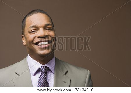 Studio shot of African businessman smiling