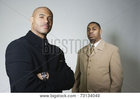 Studio shot of two African American businessmen