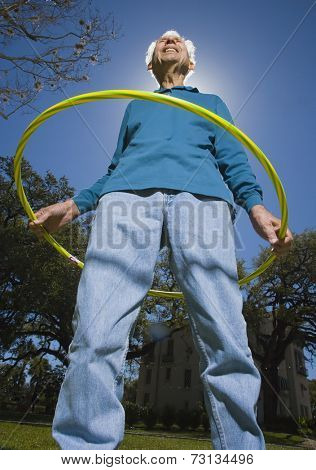 Low angle view of senior man with plastic hoop