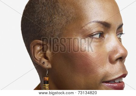 Close up studio shot of middle-aged African woman