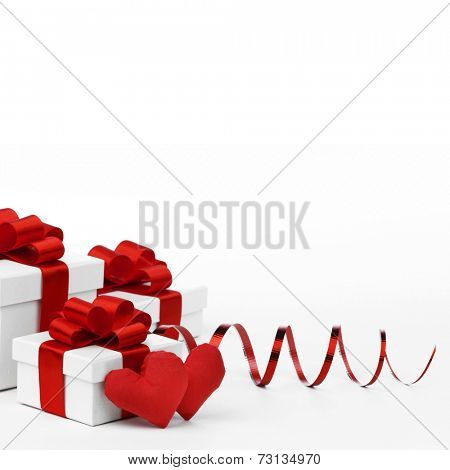 Valentines day gifts in white boxes with red ribbons and hearts isolated on white