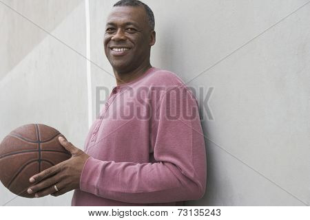African man smiling with basketball