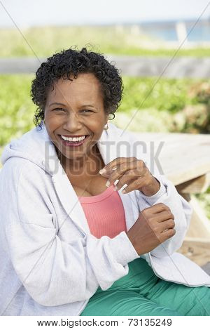 Senior woman laughing outdoors