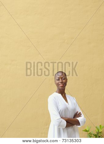 African American woman in front of blank wall outdoors