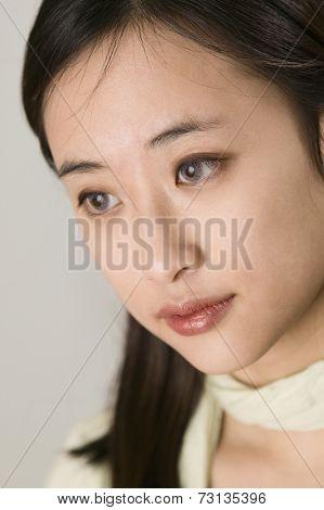 Close up studio shot of Asian woman