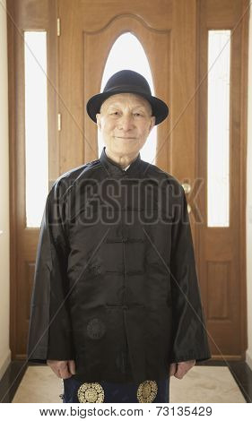 Senior Asian man smiling in traditional dress