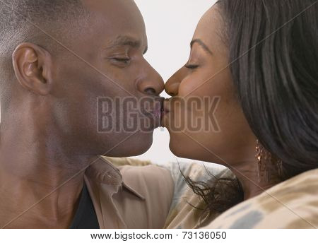 Close up of African couple kissing
