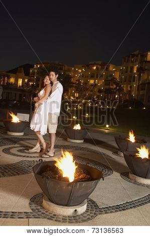 Couple hugging at resort hotel at night