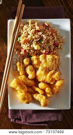 top down photo of chinese orange chicken with fried rice
