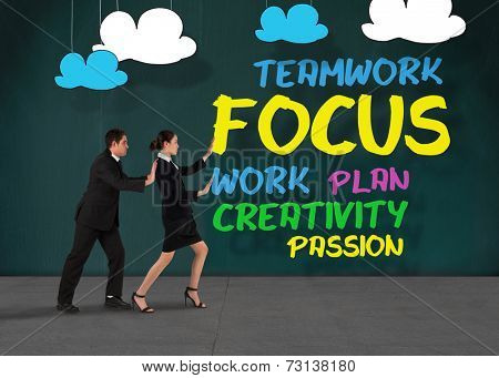 Businessman standing andComposite image of business team standing and pushing against buzz words in room